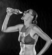 Monochrome of an Athletic Woman Drinking Water - stock photo