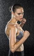 Wet Female Fighter in Combat Pose Looking Fierce Stock Photos