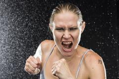 Female Fighter Shouting Out Loud at the Camera - stock photo