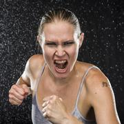 Irate Female Fighter Screaming at the Camera Stock Photos