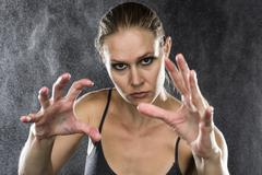 Athletic Woman Reaching Hands Towards the Camera - stock photo