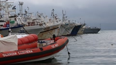Italian Coast Guard Raft Docked at Bay - stock footage