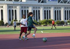 Kids playing soccer Kuvituskuvat