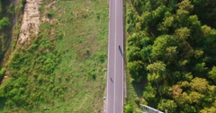 Top view of a scooter rider driving on country road Stock Footage