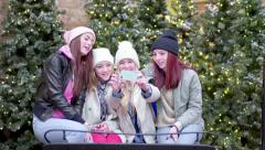 Group Of Fun Teens Take Photos Together In Santa's Sleigh At Mall - stock footage