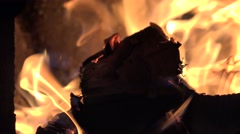 4K Closeup yellow flame flicker wood fire warmth stove tree warm high ambiance   Stock Footage