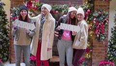 "Fun Teens Pose With ""Naughty And Nice"" Signs For Christmas Portraits At The Mall Stock Footage"