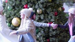 Stock Video Footage of Group Of Fun Teens Dance In Front Of Christmas Tree In Mall