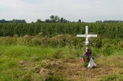 roadside remembrance cross - stock photo