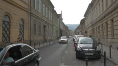 Driving cars on Poarta Schei street near the Apollonia Hirscher street, Brasov Stock Footage