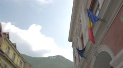 Romanian and European Union flags on Apollonia Hirscher street, Brasov Stock Footage