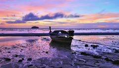 Longtail boat on the beach of Lipe island at dawn, Thailand Stock Photos