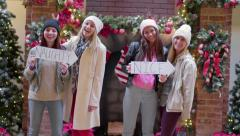 "Cute Girls Pose With ""Naughty And Nice"" Signs For Christmas Portraits At Mall Stock Footage"