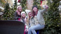 Fun Group Of Teens Take Cute Selfies Together In Santa's Sleigh In The Mall Stock Footage