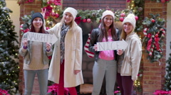 """Teens Pose With """"Naughty And Nice"""" Signs, """"Naughty"""" Girl Gives Friend Bunny Ears Stock Footage"""