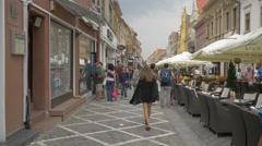 People walking on Republicii street, Brasov Stock Footage