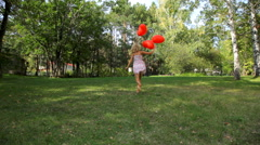 happy young woman running with red balloons - stock footage