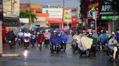 Many bikes in rainy city Stock Footage