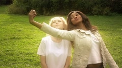Friends,  girls, caucasian and african walking in park, fooling, slow motion. Stock Footage