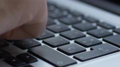 Typing on modern laptop keyboard then hit enter Stock Footage