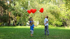 happy boys released balloons into the sky. - stock footage