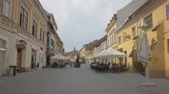 Outdoor restaurants on Michael Weiss street, Brasov Stock Footage