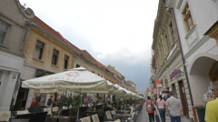 View of Republicii street and an outdoor restaurant, Brasov Stock Footage