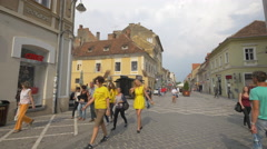 Walking on the crossroad of Republicii street and Michael Weiss street, Brasov Stock Footage