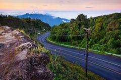 Curve road to the top of misty mountain, Chaingmai, Thailand Stock Photos