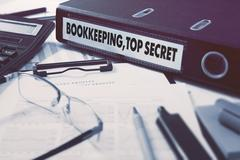 Bookkeeping,Top Secret on Ring Binder. Blured, Toned Image - stock illustration
