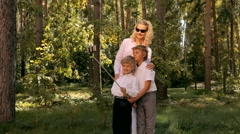 Mother and sons taking a group photo in the park - stock footage