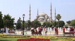 Tourists visit Blue Mosque at Sultanahmet Square.  Istanbul, Turkey Stock Footage