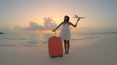 African American girl on the beach playing with model airplane Stock Footage
