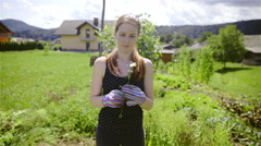 Female gardener smelling a flower and throw away 4K Stock Footage
