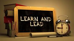 Learn and Lead Concept Hand Drawn on Chalkboard Stock Illustration
