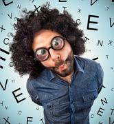 Man with thick glasses - stock photo
