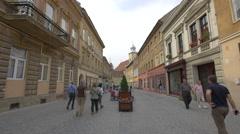 Beautiful pedestrian street near the Roman-Catholic Church, Brasov Stock Footage