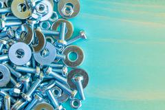 Stock Photo of Bolts and nuts on wooden background