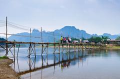 Wood bridge over river song to riverside guesthouse, Vang vieng, Laos Stock Photos