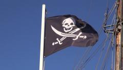 Black pirate flag waving in wind on ship mast Stock Footage