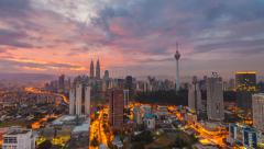 Dramatic clouds timelapse over Kuala Lumpur skyline sunrise. Pan effect. - stock footage