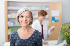 Smiling elderly patient in a pharmacy - stock photo