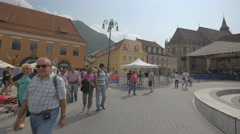 Tourists walking near the fountain of the Council Square, Brasov Stock Footage