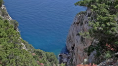 Looking Down a Cliff of Capo Caccia Sardinia Italy - 29,97FPS NTSC Stock Footage