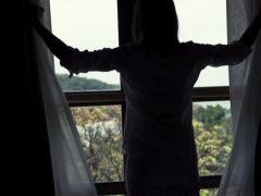 Silhouette of woman unveil curtain looking through the window, 240fps  NTSC - stock footage