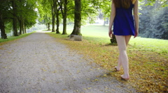 Woman walk barefoot in park 4K Stock Footage