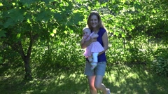Active happy mother with baby girl have fun in evening sunlight. 4K Stock Footage