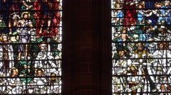 4k zoom out on stained glass in cathedral Stock Footage