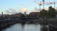 4k bridge over water with industrial background, UK Liverpool establishing shot - stock footage