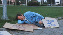 Homeless man sleeping 1 Stock Footage